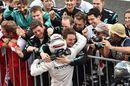 Mercedes members celebrate the winner Lewis Hamilton