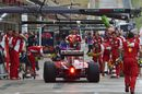 Sebastian Vettel makes a pit stop during FP1