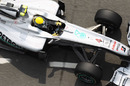 Nico Rosberg returns to his pit garage