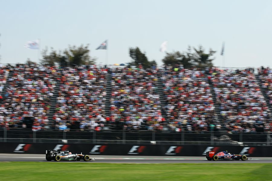 Nico Hulkenberg and Carlos Sainz battle for a postion
