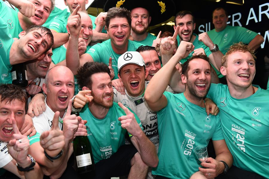 Nico Rosberg celebrates with Mercedes for his win