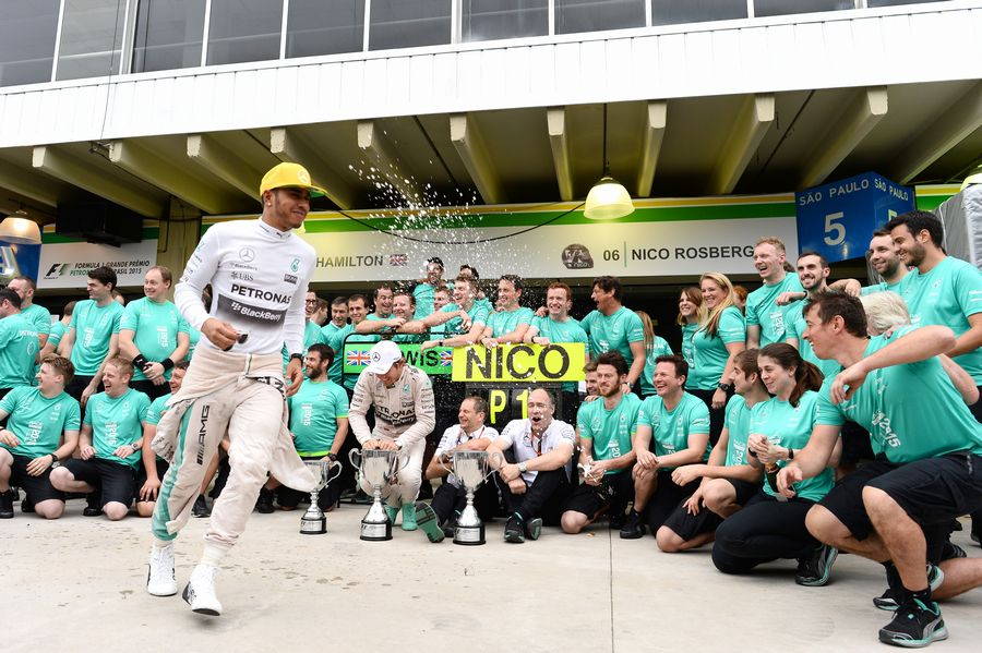 Nico Rosberg and Lewis Hamilton celebrates with Mercedes