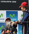 Sebastian Vettel sprays Mark Webber with champagne