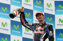 Mark Webber celebrates on the podium