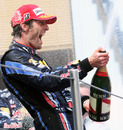 Mark Webber celebrates the spoils of victory