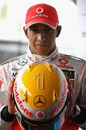 Lewis Hamilton shows of the Steinmetz diamonds embedded in his racing helmet for the 2009 Monaco Grand Prix