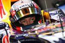 Daniil Kvyat sits in the Red Bull cockpit