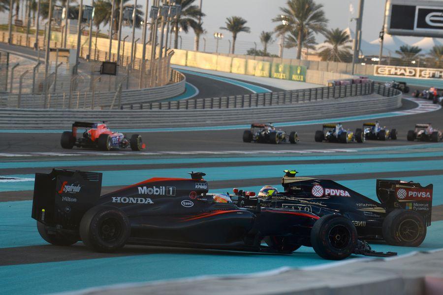 Fernando Alonso hits into Pastor Maldonado at the start of the race