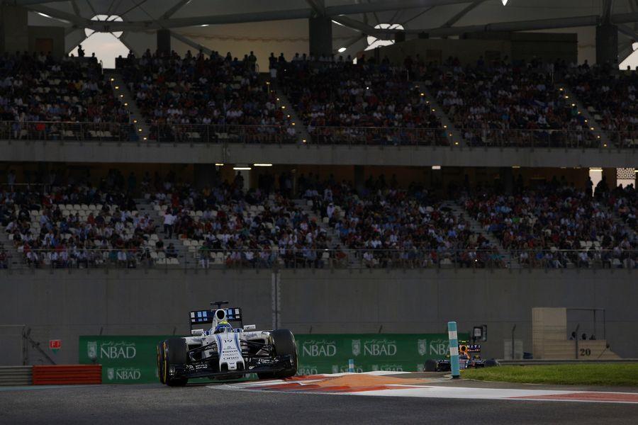 Felipe Massa rides a kerb