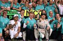 Nico Rosberg celebrates with Lewis Hamilton and Mercedes members
