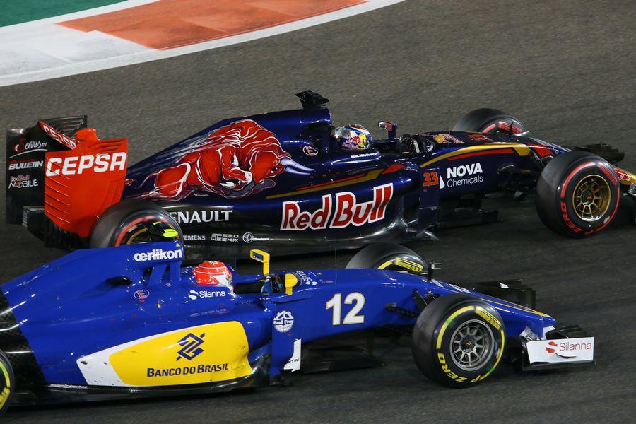 Max Verstappen and Felipe Nasr battle for a position