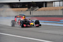 Daniil Kvyat drives on the wet track