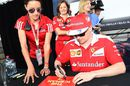 Kimi Raikkonen signs autographs for the fans