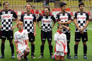 Formula One drivers line up before the Monaco All Stars soccer match