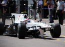 Kamui Kobayashi returns to the pits with a broken wing