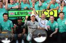 Lewis Hamilton and Nico Rosberg celebrate Mercedes' 1-2 finish with the team