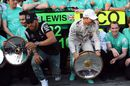 Lewis Hamilton and Nico Rosberg rush away from Merceds' champagne ceremony