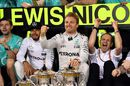 Lewis Hamilton and Nico Rosberg celebrate with the team