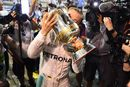 Nico Rosberg celebrates with the trophy