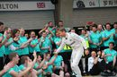 Nico Rosberg celebrates with the team