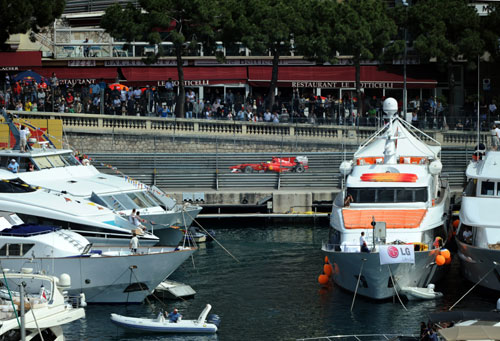 Felipe Massa roars past the yachts in the harbour