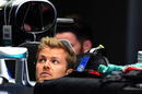 Nico Rosberg sits in the Mercedes cockpit in the garage