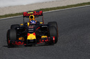 Max Verstappen turns into the apex in the Red Bull