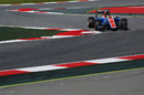 Pascal Wehrlein rides a kerb to round a corner