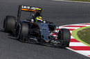 Sergio Perez turns into the corner