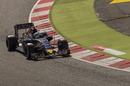 Carlos Sainz rides a kerb to round a corner