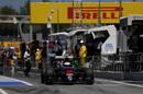 Jenson Button exits the pit lane