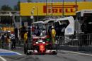 Sebastian Vettel exits the pit lane