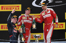 Kimi Raikkonen and Sebastian Vettel celebrate on the podium