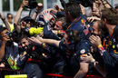 Max Verstappen celebrates with the team in parc ferme