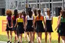 Grid girls walk before the race