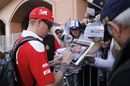 Kimi Raikkonen signs an autograph for fans