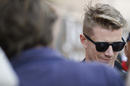 Nico Hulkenberg signs an autograph for fans
