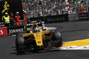 Jolyon Palmer finds a bit of air on the exit to the Swimming Pool