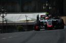 Esteban Gutierrez rides a kerb to round a corner
