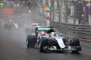 Lewis Hamilton runs through the wet track