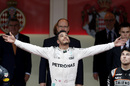 Lewis Hamilton celebrates on the podium
