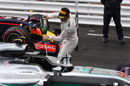 Lewis Hamilton pours champagne on his car