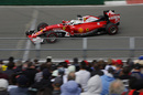 Sebastian Vettel speeds past fans
