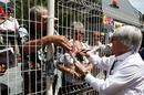 Bernie Ecclestone signs autographs