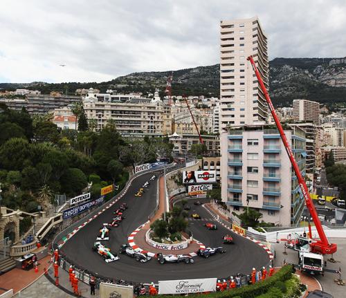 Mark Webber leads team-mate Sebastian Vettel through the hairpin on the first lap