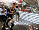 Mark Webber soaks his team with champagne
