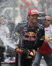 Mark Webber celebrates his win