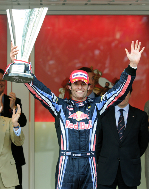 Mark Webber celebrates his win
