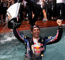 Mark Webber celebrates his win with a dip in the team pool
