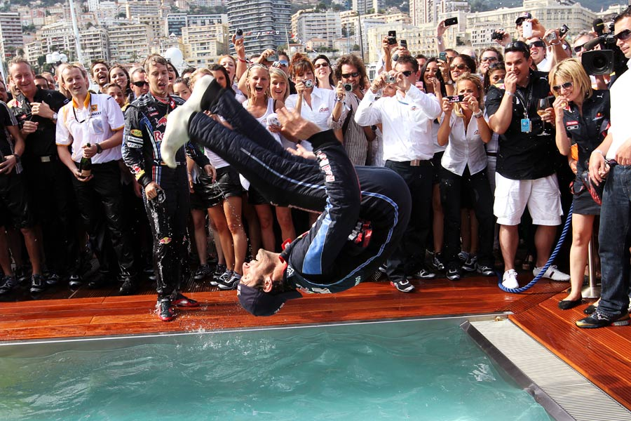 Mark Webber backflips into the team pool